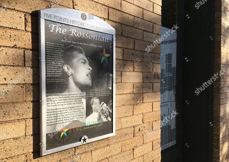 """Stock Picture of A monument to the now closed jazz club at the Rossonian Hotel informs visitors of the once celebrated spot in Denver's Five Points neighborhood that played host to Billie Holiday and Louis Armstrong in Denver, Colo. The neighborhood is where Count Basie and Miles Davis also performed and novelist Jack Kerouac wrote part of """"On The Road."""" The historic black neighborhood is facing gentrification with new breweries and coffee shops near buildings that once housed jazz clubs and consequential black-owned businesses"""