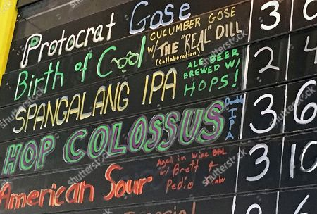 """A list of jazz-inspired beer is shown at Spangalang Brewery, a bar in Denver's Five Points neighborhood. The historic black neighborhood was often called """"The Harlem of West,"""" a place where Billie Holiday, Count Basie and Miles Davis performed and novelist Jack Kerouac tried to capture the spirit of the bebop movement in """"On The Road."""" The brewery's name, Spangalang, is the term used to describe the bread and butter jazz cymbal rhythm"""
