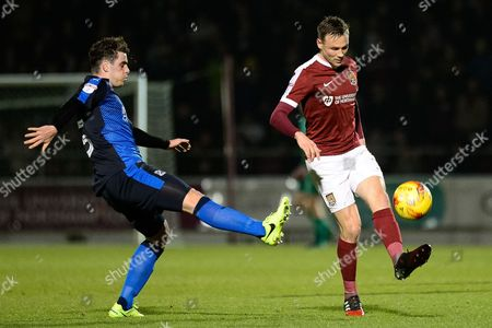 Swindon Town midfielder Anton Rodgers (5) moves in to tackle Northampton Town midfielder Matt Taylor (31) during the EFL Sky Bet League 1 match between Northampton Town and Swindon Town at Sixfields Stadium, Northampton
