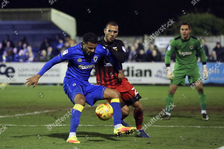 AFC Wimbledon striker Andy Barcham (17) battles for possession withc20\ during the EFL Sky Bet League 1 match between AFC Wimbledon and Coventry City at the Cherry Red Records Stadium, Kingston