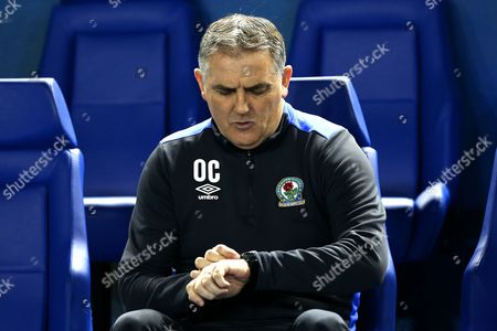 Blackburn Rovers manager Owen Coyle checks his watch