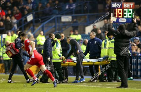 Blackburn Rovers manager Owen Coyle checks on an injured Sam Gallagher as he is stretchered off the field