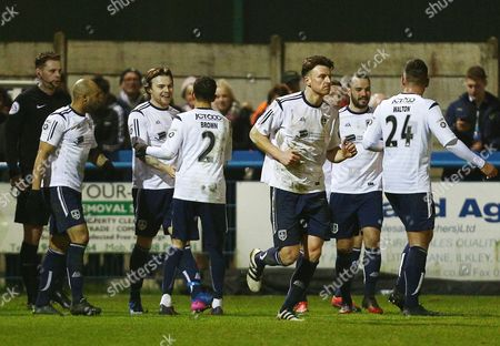 John Rooney of Guiseley celebrates scoring his goal to make it 2-1 with his team-mates during the Vanarama National League match between Guiseley and Sutton United played at Nethermoor Park, Guiseley, on 14th February 2017