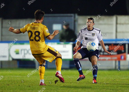 John Rooney of Guiseley and Matt Tubbs of Sutton United during the Vanarama National League match between Guiseley and Sutton United played at Nethermoor Park, Guiseley, on 14th February 2017