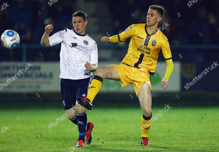 John Rooney of Guiseley and Adam May of Sutton United during the Vanarama National League match between Guiseley and Sutton United played at Nethermoor Park, Guiseley, on 14th February 2017