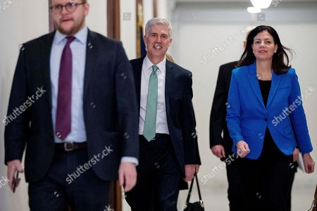 Neil Gorsuch, Kelly Ayotte Supreme Court Justice nominee Neil Gorsuch, center, accompanied by former New Hampshire Senator Kelly Ayotte, right, arrives to meet with Senator Chris Coons, D-Del., on Capitol Hill in Washington
