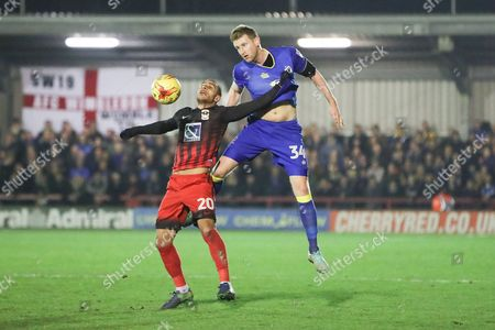 Stock Photo of AFC Wimbledon defender Chris Robertson (34) nd Coventry City striker Marcus Tudgay (20) during the EFL Sky Bet League 1 match between AFC Wimbledon and Coventry City at the Cherry Red Records Stadium, Kingston