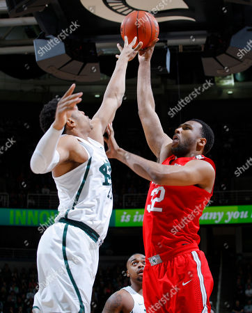 Trevor Thompson, Miles Bridges Ohio State's Trevor Thompson, right, shoots against Michigan State's Miles Bridges during the first half of an NCAA college basketball game, in East Lansing, Mich