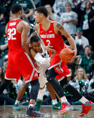 Marc Loving, Alvin Ellis III, Trevor Thompson Ohio State's Marc Loving, right, drives against Michigan State's Alvin Ellis III, center, as Ellis is screened by Ohio State's Trevor Thompson (32) during the second half of an NCAA college basketball game, in East Lansing, Mich. Michigan State won 74-66