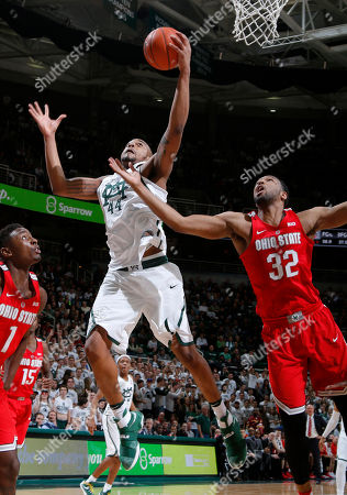 Nick Ward, Trevor Thompson, Jae'Sean Tate Michigan State's Nick Ward, center, pulls down a rebound against Ohio State's Trevor Thompson (32) and Jae'Sean Tate (1) during the second half of an NCAA college basketball game, in East Lansing, Mich. Michigan State won 74-66