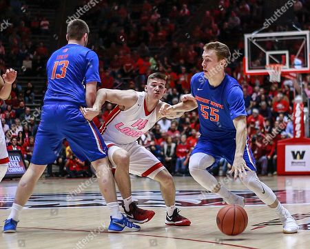 Boise State's David Walker (55) dribbles around New Mexico's Dane Kuiper (14) during the first half of an NCAA college basketball game in Albuquerque, N.M