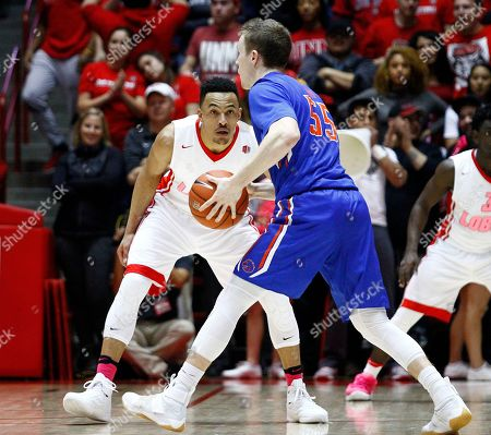 New Mexico's Elijah Brown (4) defends Boise State's David Walker (55) during the second half of an NCAA college basketball game in Albuquerque, N.M., . New Mexico won 78-73
