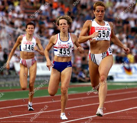 Stock Photo of Budapest Hungary: Germany^s Grit Breuer (r) on Her Way to Qualify For the Women^s 400 M Final at the European Athletics Championships in Budapest 20 August on (l) Jitka Burianova of the Czech Republic and (c) Britain^s Allison Curbishley
