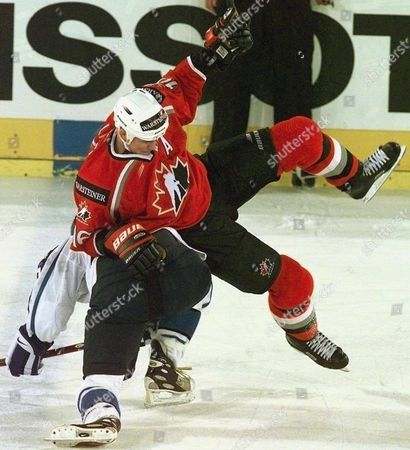Zurich Switzerland: Canadas Trevor Linden Falls Over Finlands Antti-jussi Niemi During Their Match at the Ice Hockey World Championship in Zurich 09 May the Match Ended 3-3
