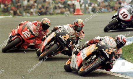 Donington United Kingdom : Spains Alex Criville on Honda Leads Tadayuki Okada ( United Kingdom Donington