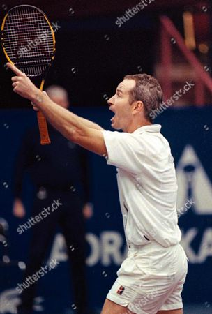 Zagreb Croatia: Us Tennis Veteran John Mcenroe Jubilates After He Defeated Guy Forget of France in the Final of the Atp Senior Tour of Champions in Zagreb 16 November John Mcenroe Receives 30 000 $ For His Victory Mcenroe Won 6-1 and 7-6 (7-4)