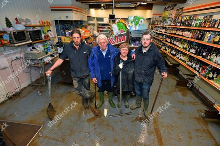 The Brown Family Who Have Lost 50%-60% Of Shop Stock From Glenridding Mini-market Which Has Been Operating For More Than 33 Years. - (l To R) Son Stephen 29 Father Alan Brown 75 Wife Avril 57 And Son Craig 24.- Devastation In The Lake District Village Of Glenridding Cumbria After Trees And Rubble Slip Off Nearby Mountainsides In The Village.