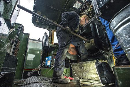 Editorial picture of Welder Nick Bartle (pictured) Fits A Baffle Plate To The Fire Box Of The Flying Scotsman. Robert Hardman Visits The Workshop Of Riley And Son Ltd In Bury Lancs Where A £4 Million Restoration Of The Steam Locomotive 'flying Scotsman' Is Due To Be Co