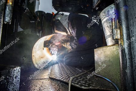 Stock Image of Welder Nick Bartle (pictured) Makes A Baffle Plate For The Fire Box Of The Flying Scotsman. Robert Hardman Visits The Workshop Of Riley And Son Ltd In Bury Lancs Where A ô Million Restoration Of The Steam Locomotive 'flying Scotsman' Is Due To Be CoMPleted..