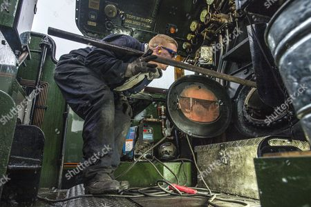 Stock Photo of Welder Nick Bartle (pictured) Fits A Baffle Plate To The Fire Box Of The Flying Scotsman. Robert Hardman Visits The Workshop Of Riley And Son Ltd In Bury Lancs Where A ô Million Restoration Of The Steam Locomotive 'flying Scotsman' Is Due To Be CoMPleted..