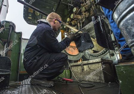 Stock Picture of Welder Nick Bartle (pictured) Fits A Baffle Plate To The Fire Box Of The Flying Scotsman. Robert Hardman Visits The Workshop Of Riley And Son Ltd In Bury Lancs Where A ô Million Restoration Of The Steam Locomotive 'flying Scotsman' Is Due To Be CoMPleted..