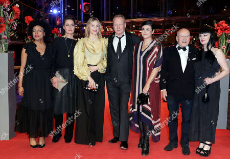 From left, actress Isi Laborde-Edozien, actress Susanne Wolff, actress Nina Hoss, actor Stellan Skarsgard, Skarsgard's wife Megan Everett, director Volker Schloendorff and actress Bronagh Gallagher pose for the media on the red carpet for the film 'Return to Montauk' at the 2017 Berlinale Film Festival in Berlin, Germany