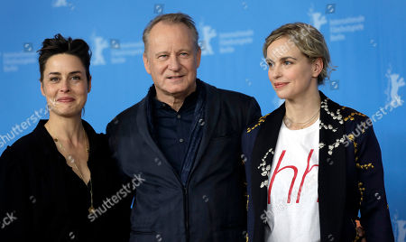 From left, actors Susanne Wolff, Stellan Skarsgard and Nina Hoss pose for the photographers during a photo call for the film 'Return to Montauk' at the 2017 Berlinale Film Festival in Berlin, Germany
