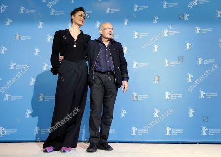 Actress Susanne Wolff, left, and director Volker Schloendorff, right, pose for the photographers during a photo call for the film 'Return to Montauk' at the 2017 Berlinale Film Festival in Berlin, Germany
