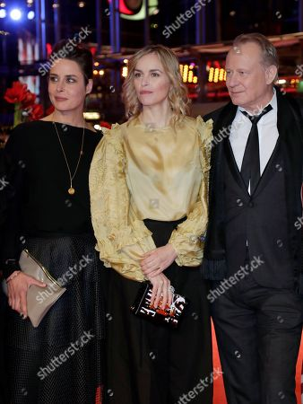 From left, actors Susanne Wolff, Nina Hoss and Stellan Skarsgard pose for the media on the red carpet for the film 'Return to Montauk' at the 2017 Berlinale Film Festival in Berlin, Germany