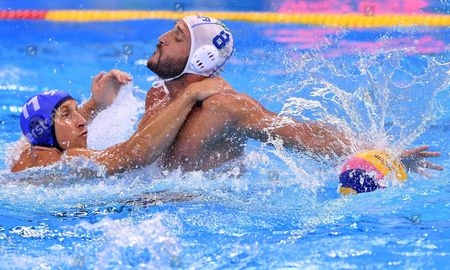 Valentino Gallo (r) of Italy in Action Against Andrija Prlainovic (l) of Serbia During the Men's Water Polo Semi Final Match Between Serbia and Italy of the Rio 2016 Olympic Games at the Olympic Aquatics Stadium in the Olympic Park in Rio De Janeiro Brazil 18 August 2016 Brazil Rio De Janeiro