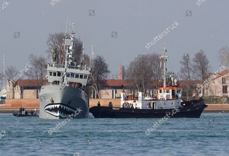 Stock Picture of The 'My Bob Barker' the Ship of the Sea Shepherd Conservation Society with Its Iconic Shark-mouth Painting on the Bow is Helped by a Tug Boat (r) After It Ran Aground in the Channel of Certosa in Front of the Lido of Venice While on Its Journey to the San Marco Pier in Venice Italy 06 February 2016 the Former Whale Catching Ship is Named After Us Television Host and Animal Rights Activist Bob Barker and Reportedly Serves the Organization As a Campaign Vessel Against Whalers From Mainly Japan Since 2010 Italy Venice