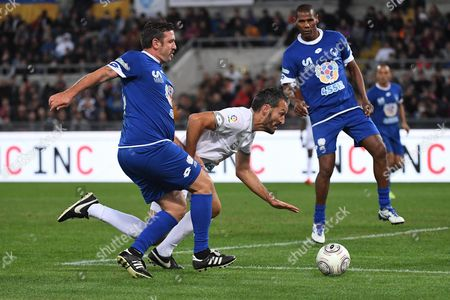 Vincent Candela (l) and Gianluca Zambrotta in Action During the 'Match of Peace - United For Peace' Charity Soccer Match Promoted by the Schools For Encounter Foundation an Organization Boosted by Pope Francis at Olimpico Stadium in Rome Italy 12 October 2016 Italy Rome