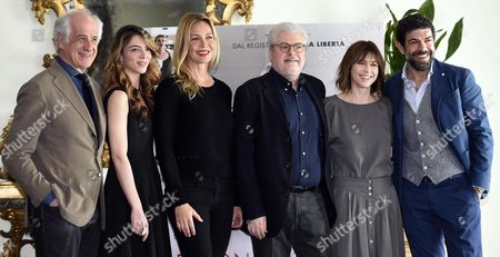 (l-r) Actors/cast Members Toni Servillo Giulia Ando' Connie Nielsen Italian Filmmaker Roberto Ando' Actors/cast Members Marie-josee Croze and Pierfrancesco Favino Pose For Photographs During the Photo Call For the Movie 'Le Confessioni' in Rome Italy 11 April 2016 the Movie Will Be Released in Italian Theaters on 21 April Italy Rome
