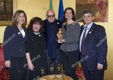(l-r) the Mayor of Lampedusa and Linosa Giusi Nicolini the Producer Donatella Palermo the Director Gianfranco Rosi the President of Italian Chamber of Deputies Laura Boldrini and Pietro Bartolo Head of the Medical Center of Lampedusa Meet to Celebrate That Gianfranco Rosi's Documentary Film 'Fuocoammare' Won the Bear Prize For Best Film at the Berlin International Film Festival at Montecitorio Palace in Rome Italy 25 February 2016 Italy Rome