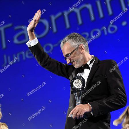 Ukraine's Director Igor Lopatonok Recives the 'Taormina City Award' For His Movie 'Ukraine on Fire' During a Ceremony at the Teatro Antico As Part of the 62nd Annual Taormina Film Festival Taormina Sicily Island Italy Late 16 June 2016 the Festival Runs From 11 to 18 June Italy Taormina