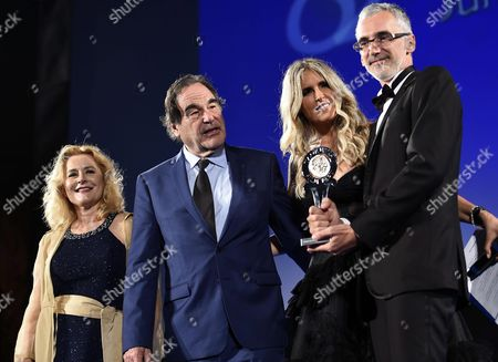 (l-r) Italian Producer Eleonora Granata Us Director and Producer Oliver Stone Festival General Manager Tiziana Rocca and Ukraine's Director Igor Lopatonok Pose For Photographers After Recived the 'Taormina City Award' For the Movie 'Ukraine on Fire' During a Ceremony at the Teatro Antico As Part of the 62nd Annual Taormina Film Festival Taormina Sicily Island Italy Late 16 June 2016 the Festival Runs From 11 to 18 June Italy Taormina