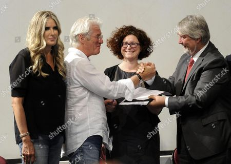(l-r) Festival General Manager Tiziana Rocca Us Actor Richard Gere Cristina Avonto the President of the Fio Psd (italian Federation of Organizations For the Homeless) and Italian Minister of Labour and Social Policy Giuliano Poletti Attend a Press Conference Held to Present the 'Project #homelesszero' As Part of the 62nd Annual Taormina Film Festival in Taormina Italy 11 June 2016 the Film Festival Runs From 11 to 18 June Italy Taormina