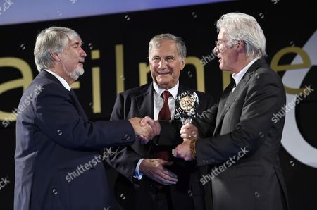 (l-r) Italian Minister of Labour and Social Policy Giuliano Poletti Us Ambassador to Italy John R Phillips and Us Actor Richard Gere to Presenting the 'Project #homelesszero' After Gere Received the 'Humanitarian Taormina Award' As Part of the 62nd Annual Taormina Film Festival During the Opening Ceremony at the Teatro Antico As Part of the 62nd Annual Taormina Film Festival Taormina Sicily Island Italy 11 June 2016 the Festival Runs From 11 to 18 June Italy Taormina