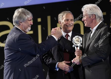 (l-r) Italian Minister of Labour and Social Policy Giuliano Poletti Us Ambassador to Italy John R Phillips and Us Actor Richard Gere Presenting the 'Project #homelesszero' After Gere Received the 'Humanitarian Taormina Award' As Part of the 62nd Annual Taormina Film Festival During the Opening Ceremony at the Teatro Antico As Part of the 62nd Annual Taormina Film Festival Taormina Sicily Island Italy 11 June 2016 the Festival Runs From 11 to 18 June Italy Taormina