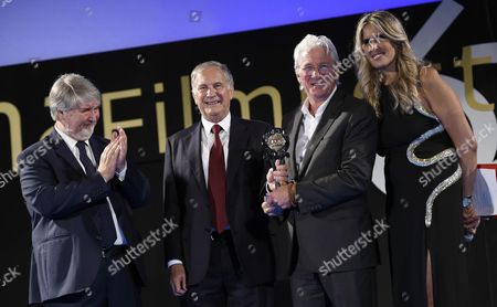 (l-r) Italian Minister of Labour and Social Policy Giuliano Poletti Us Ambassador to Italy John R Phillips Us Actor Richard Gere and Festival General Manager Tiziana Rocca Presenting the 'Project #homelesszero' After Gere Received the 'Humanitarian Taormina Award' As Part of the 62nd Annual Taormina Film Festival During the Opening Ceremony at the Teatro Antico As Part of the 62nd Annual Taormina Film Festival Taormina Sicily Island Italy 11 June 2016 the Festival Runs From 11 to 18 June Italy Taormina