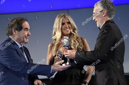 Ukraine's Director Igor Lopatonok (r)recives the 'Taormina City Award' For His Movie 'Ukraine on Fire' From Us Director Oliver Stone (l) and Festival General Manager Tiziana Rocca (c) During a Ceremony at the Teatro Antico As Part of the 62nd Annual Taormina Film Festival Taormina Sicily Island Italy Late 16 June 2016 the Festival Runs From 11 to 18 June Italy Taormina