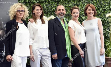 (l-r) Italian Actress/cast Member Eva Grimaldi Ukrainian-born Actress/cast Member Anna Safroncik Italian Filmmaker Massimo Natale Italian Actresses/cast Members Claudia Gerini and Silvia Delfino Pose For Photographs During the Photo Call For the Movie 'Il Traduttore' (the Translator) in Rome Italy 24 May 2016 the Movie Will Be Released in Italian Theaters on 26 May Italy Roma