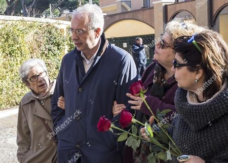 Former Mayor of Rome Walter Veltroni (2-l) Walks with Ettora Scola's Widow (l) Gigliola and Scola's Daugthers Silvia (r) and Paola (2-r) at Funeral Home in Rome Italy 20 January 2016 Ettore Scola Died on 19 January 2016 in Rome Italian Media Reported Scola Winner of the Best Director at the 1976 Cannes Film Festival Died Two Days After Going Into a Coma He was 84 Italy Rome