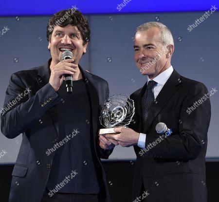 Italian Producer Giampaolo Letta (r) and Italian Actor Fabio De Luigi (l) Receive the 'Taormina Arte Award' During a Ceremony at the Teatro Antico As Part of the 62nd Annual Taormina Film Festival in Taormina Sicily Island Italy Late 18 June 2016 the Festival Runs From 11 to 18 June Italy Taormina