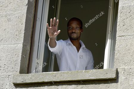 Rudy Guede Looks out the Window of Gavac Volunteer Centre For Prisoner Assistance in Viterbo 25 June 2016 Guede Convicted in 2008 of the Murder of British Student Meredith Kercher and Currently Serving a 16-year Sentence at a Prison on the Outskirts of Viterbo Has Been Granted a 36-hour Release That Starts Saturday Morning Guede who Has Maintained His Innocence Will Stay at the Gavac Volunteer Centre For Prisoner Assistance in Viterbo Through the Weekend and Return to Prison by 9pm on Sunday He is the Only Person Convinced of the 2007 Murder After American Amanda Knox and Her Italian Former Boyfriend Raffaele Sollecito Were Acquitted Last Year Italy Viterbo