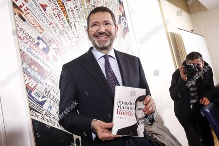 Former Rome Mayor Ignazio Marino Holds a Copy of His Book 'Un Marziano a Roma' (a Martian in Rome) During Its Presentation in Rome Italy 30 March 2016 Marino Said That He Might Have Ended Up in Jail if He Had Followed the Advice of His Democratic Party (pd) While He was in Charge of the City 'If i Had Followed All the Advice of the Pd Maybe They Would Have Put Me in an Isolation Cell ' Marino Said at the Presentation of a New Book He Has Written when Asked if He Had Been Isolated Politically During His Time As Mayor Italy Rome