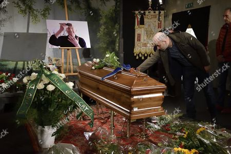 Stock Image of Italian Writer Roberto Saviano Pays His Tribute at the Coffin of Italian Writer Actor Political Campaigner and Recipient of the Nobel Prize in Literature Dario Fo at a Mortuary Chapel in Milan Italy 15 October 2016 Fo Died at Age 90 in Milan Italy Milan