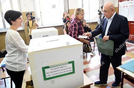 Ac Milan's Ceo Adriano Galliani (r) Arrives at a Polling Station to Cast His Vote in the Municipal Elections at a Polling Station in Milan Northern Italy 05 June 2016 Others Are not Identified Local Elections Are Underway Across Italy Including Mayoral Votes in Rome Milan Turin and Naples Italy Milan