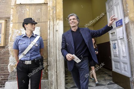 Alfio Marchini (r) the Center-right Candidate For the Post of the New Mayor in Rome Leaves a Polling Station After Casting His Vote in the Municipal Elections in Rome Italy 05 June 2016 Local Elections Are Underway Across Italy Including Mayoral Votes in Rome Milan Turin and Naples Italy Rome
