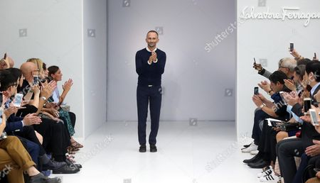 Stock Photo of Italy's Fashion Stylist Fulvio Rigoni Greets the Crowd at the End of the Presentation of Italian Fashion Lab Salvatore Ferragamo During the Women's Fashion Week in Milan 25 September 2016 the Women's Collections Are Presented at the Milano Moda Donna From 21 to 26 September Italy Milan